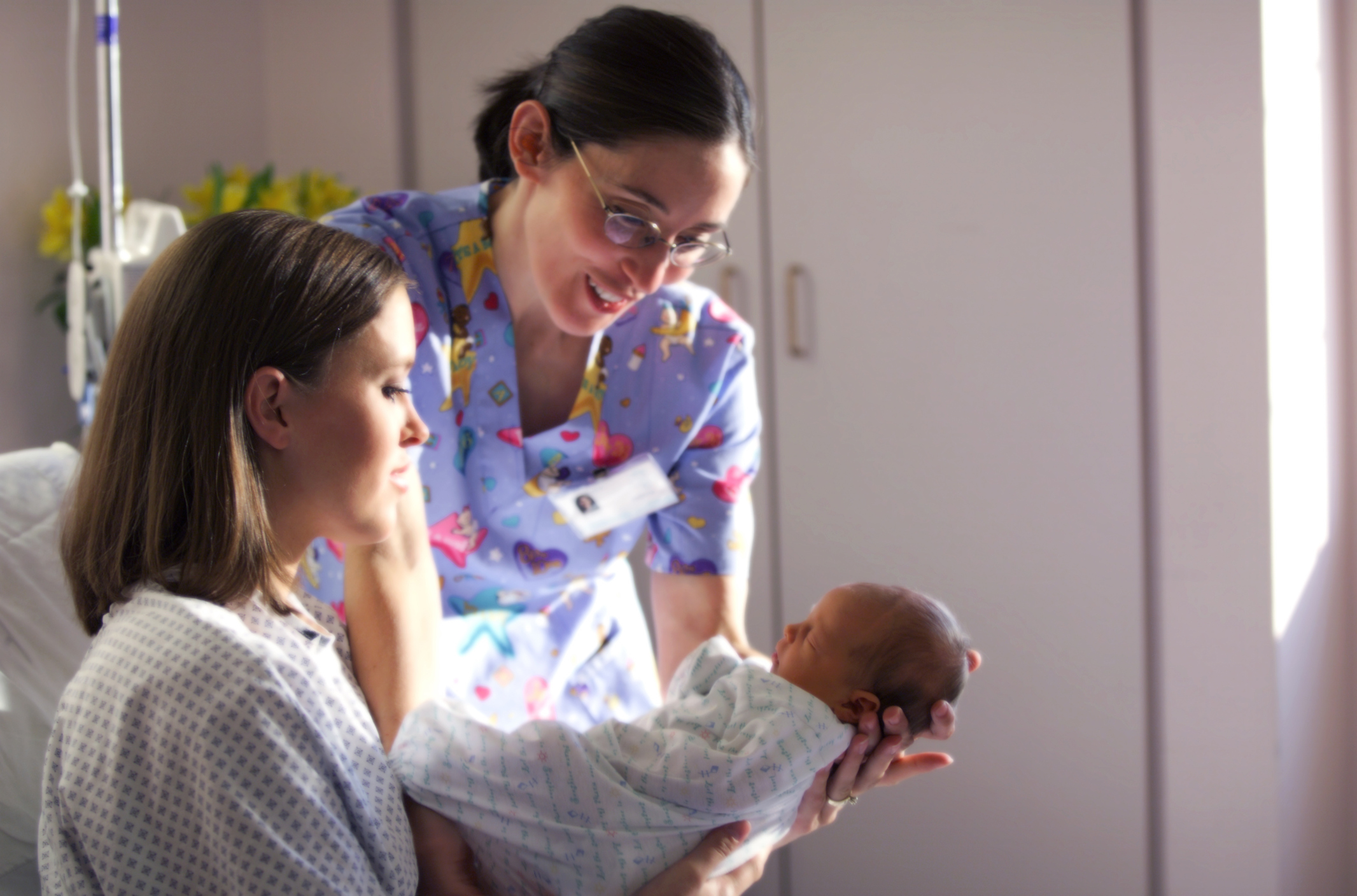 Baby with mom and nurse