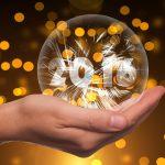Hand holding 2016 glass globe
