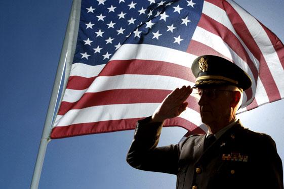 veteran-saluting-in-front-of-flag