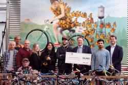 Good Karma Bikes Group with check