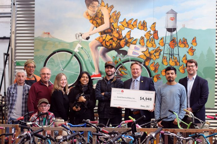 Good Karma Bikes Group with check