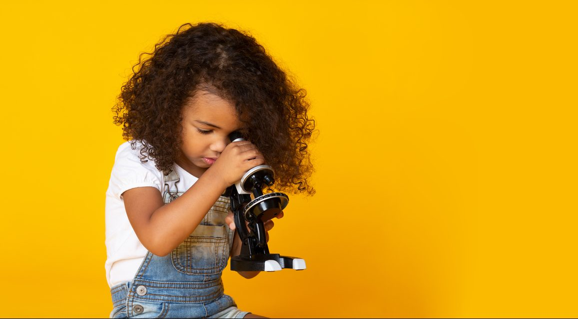 little girl with microscope