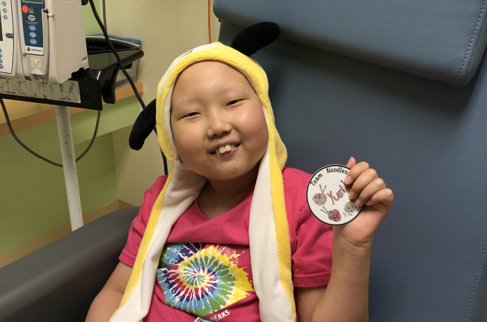 Zoe with yellow hat at hospital